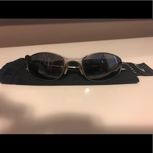 Oakley Sunglasses. Silver Metal Frame